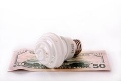 Fluorescent bulb with money Royalty Free Stock Image