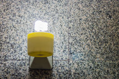 Fluorescent bulb. On tile background Royalty Free Stock Images