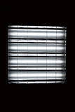Fluorescent lamp on the black background Royalty Free Stock Image