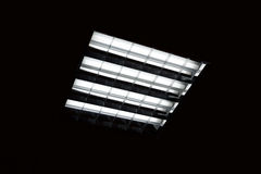 Fluorescent lamp on the black background Royalty Free Stock Photo