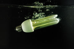 Fluorescent lamp falls into the water Stock Photo