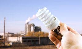 Fluorescent lamp in hand Royalty Free Stock Images