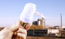 Fluorescent lamp in hand Stock Image