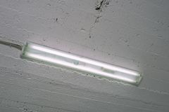 Fluorescent lamp in an industrial room close stock photos