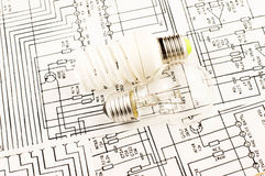 Fluorescent lamp and lamp incandescence. Against the background drawings of microcircuits Stock Photo