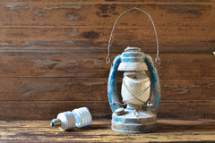 Fluorescent lamp and old lantern vintage on the wooden Stock Images