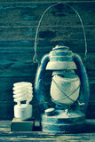 Fluorescent lamp and old lantern vintage on the wooden Royalty Free Stock Image