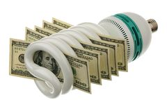 Fluorescent lamp and US dollars Stock Image