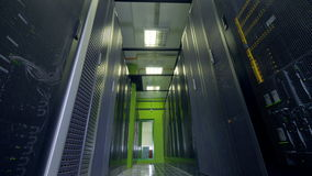 Fluorescent tube lamps illuminate a data storage aisle. stock footage