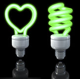 Fluorescent lamps, spiral shaped, heart shaped, green glow, 3d rendering on dark background Stock Photo
