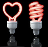 Fluorescent lamps, spiral shaped, heart shaped, red glow, 3d rendering on dark background Stock Images