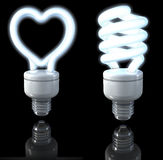 Fluorescent lamps, spiral shaped, heart shaped, white glow, 3d rendering on dark background Stock Photo
