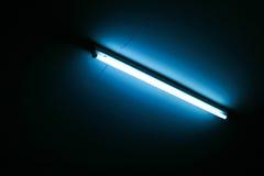 Fluorescent light. Blue fluorescent light in the dark Stock Images