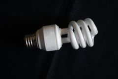 Fluorescent Light bulb. Compact fluorescent light bulb on black Stock Photography