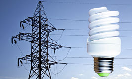 Fluorescent light bulb on a background electric line support Stock Photos