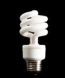 Fluorescent light bulb on black Stock Photos