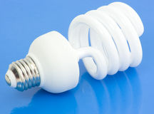 Fluorescent Light Bulb on Blue Royalty Free Stock Photo