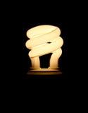 Fluorescent Light Bulb. Electrified fluorescent light bulb over black Stock Photos