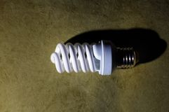 fluorescent light bulb, on a green background Stock Photo
