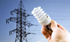 Fluorescent light bulb in his hand Royalty Free Stock Image
