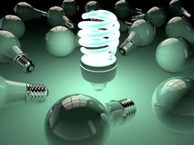 Fluorescent light bulb shining among old ones Royalty Free Stock Image