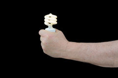 Fluorescent light. Man holding a pigtail flourescent light suggesting it is the way of the future to conserve power royalty free stock image