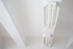 Fluorescent lights tube. And rails on white ceiling office stock photos