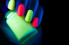 Fluorescent nail polish Stock Images