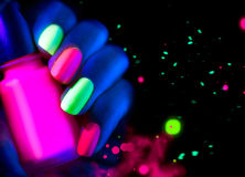 Fluorescent nailpolish. Fashion nails in neon light Stock Images