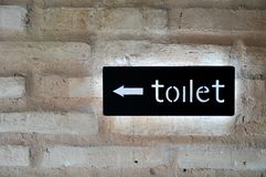 Fluorescent toilet sign Stock Photos