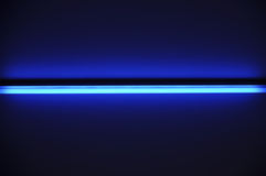 Fluorescent tube. Shining ray on dark blue background stock image