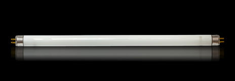 Fluorescent tube lamp. On a black background stock image