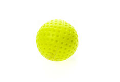 Fluorescent yellow old and dirty golf ball isolated on white. Colour olfing sports equipment and accessories isolated on white background Royalty Free Stock Photo