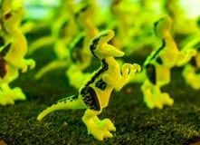 Fluorescerande T-Rex leksak fotografering för bildbyråer
