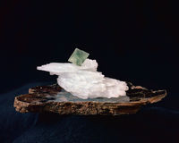 Fluorite, anhydrite on mica. Fluorite crystal resting on anhydrite and slab of mica; high resolution film Stock Photo