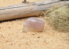 Fluorite on beach Royalty Free Stock Photography