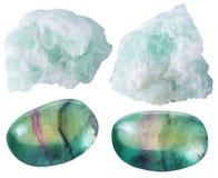 Fluorite (fluorspar) dråsade ädelstenstenar och vaggar Arkivfoton