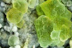 Fluorite mineral. Fluorite is a intense green mineral with rumble shape Stock Photography
