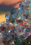 Fluorspar crystal. Mineral on coloured background Royalty Free Stock Image
