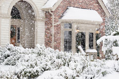 Flurries of snow outside home Royalty Free Stock Photos