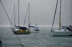Flurry at anchorage. Heavy flurry of rain at the anchorage of sailing boats on Rio Dulce, near the town of Fronteras. Guatemala royalty free stock photo