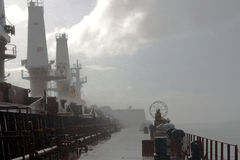 A flurry of wind and rain on the ship Stock Images