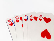 Flush Card in Poker Game with White Background. A playing card is a piece of specially prepared heavy paper, thin cardboard, plastic-coated paper, cotton-paper Royalty Free Stock Photos