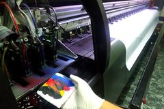 Flush and clean printheads of chinese printer. Large and big printer manual cleaned printheads for best jetting colors ink of printer in CMYK mode. Standby the Stock Photos