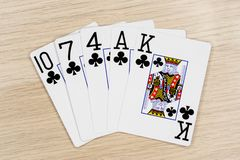 Flush clubs - casino playing poker cards royalty free stock photos