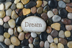 Flush Pebble Stone and River Background with the word Dream Stock Image
