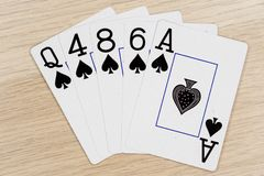 Flush spades - casino playing poker cards. Flush spades - winning hand of gambling casino poker playing cards on a table stock image