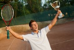 Flush of victory on tennis court Stock Photography