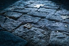 Flush view of a cobblestone floor with sunlight entrance royalty free stock photography