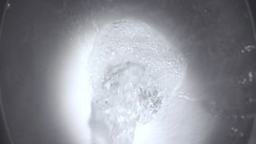 Flush water in the toilet in the close-up slow motion 250FPS. Flush water in the toilet in the close-up slow motion 250FPS stock video footage